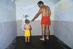 Father and son in public restroom.