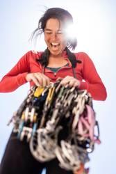 Female rock climber organizing gear.