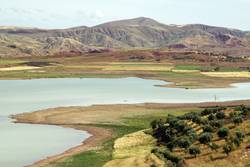 Morocco landscape with lake and green fields