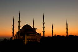 The Beatiful Blue Mosque with all 6 minarets in a sunset scene