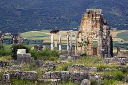 Old Roman Columns and Citry Entrance, Volubilis, Morocco