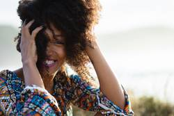 Portrait of happy afro hairstyle woman