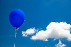 Blue baloon flying in the sky