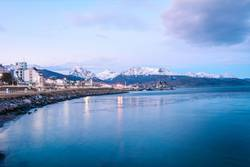 A view of Ushuaia and mountains in winter.