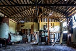 Abandoned Cannery Warehouse Interior with Rusty Machines