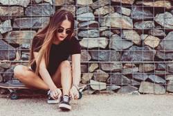 beautiful young woman tying shoelace