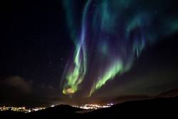 Glows of Northern Lights with shining stars on the sky