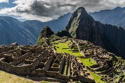 Panoramic view from the top to old Inca ruins and Wayna Picchu
