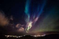 Aurora Borealis with shining stars on the sky
