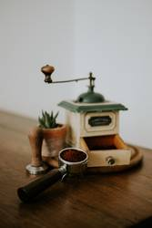 Old coffee grinder on wooden table