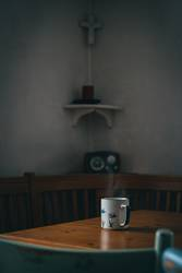 A cup of hot tea on a wooden table