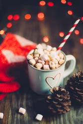 Christmas hot chocolate with socks and pine cones