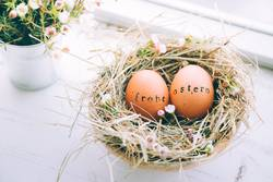 Easter eggs with Frohe Ostern text stamp