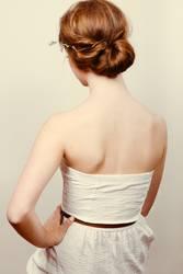 Redhead bride with romantic bun