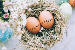 Easter eggs with greeting text stamp in german