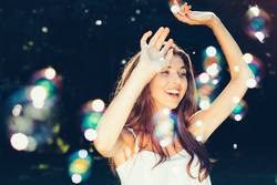 Girl dancing with bubbles