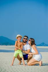 Happy young family of three having fun