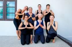 Female yoga students and their yoga teacher.