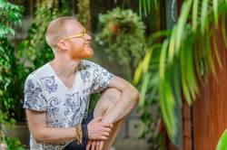 Yoga teacher portrait. Red hair man with a red beard