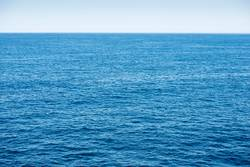 Blue ocean background with blue sky