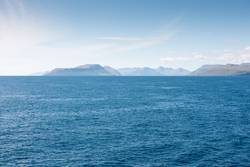 Landscape on the Faroe Islands as seen from a ship
