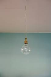 hanging light bulb blue pastel background.
