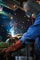 Welder is welding in the garage,industrial Worker
