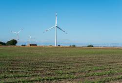 Wind generator and agricultural land.