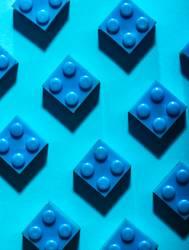 Blue unicolour plastic geometric cubes. Construction toys