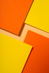 Yellow and orange color paper material design. Geometric