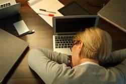 Woman sleeping on office desk