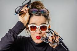 Real girl with various glasses and red lips gesturing