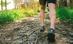 Feet of man participating in trail race