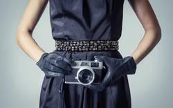 Beautiful fashion girl with an analogue photo camera
