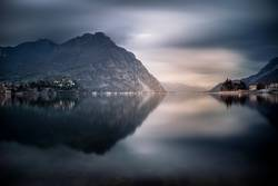 The mountains around Lecco reflected on the lake
