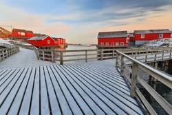 Red cottages-rorbuer. Wooden gangplanks. A i Lofoten-Norway-0328