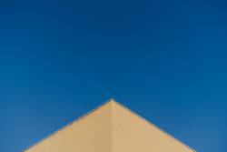 detail of a yellow corner over blue sky background