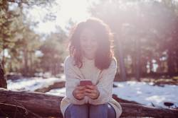 young beautiful woman outdoors using mobile phone