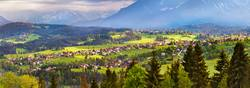 Malopolska village and green spring meadows on hills