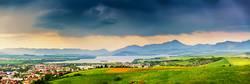 Spring storm mountain panorama. Overcast dramatic sky