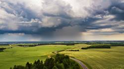 Thunderstorm over a wheat field. Rural scene