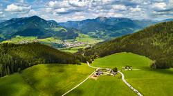 Spring travel in Austria. Green fields and meadows