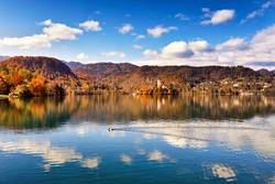Amazing autumn View On Bled Lake. Slovenia Mountain Range