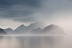 Summer cloudy Lofoten islands. Norway misty sea and fjords