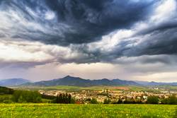 Spring storm in mountains. Overcast dramatic sky