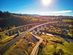 Old railway viaduct in mountains. Autumn Rural Landscape