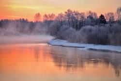 Misty winter dawn on the river. Belarus