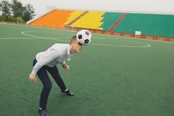 office worker plays with a soccer ball head