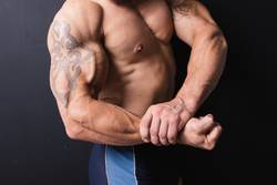 hand a powerful bodybuilder with a tattoo