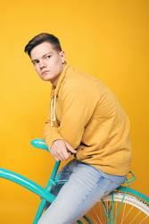 the guy sitting on the bike